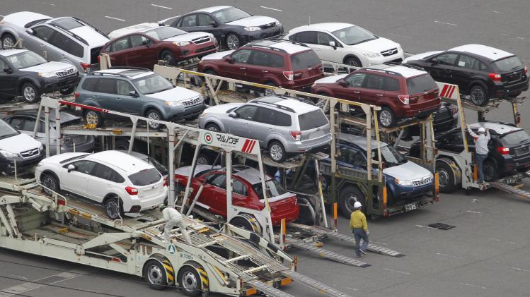 In this photo taken  Jan. 19, 2012, Japanese cars are unloaded from trailer trucks before being shipped for export at a port in Kawasaki near Tokyo. Japan's industrial production rebounded 4 percent in December from November and household spending increased, suggesting the still-weak economy is gaining some steam after last year's tsunami disaster and flooding in Thailand that disrupted manufacturers' supply chains. Manufacturers project further production increases in January and February, the Ministry of Economy, Trade and Industry said Tuesday, Jan. 31. (AP Photo/Koji Sasahara)