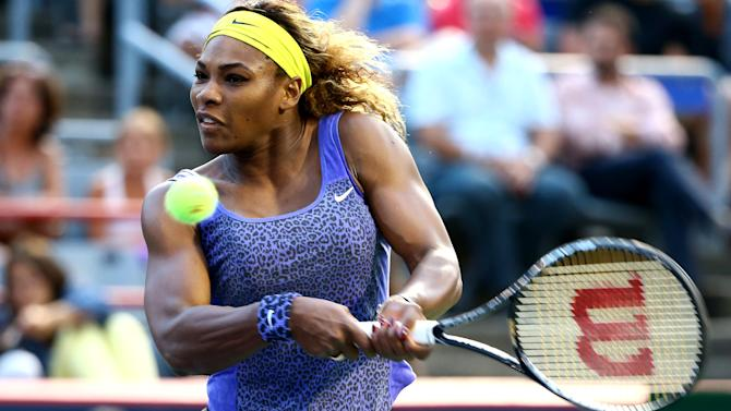 Serena Williams returns a shot to Samantha Stosur during their Rogers Cup match in Montreal on August 6, 2014