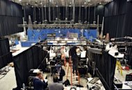Television crews set up inside the debate hall as preparations continue for the second presidential debate at Mack Arena at Hofstra University in Hempstead, New York. President Barack Obama, guarding presidential dignity, will not be as brash, but is under pressure to show more stomach for the fight against an opponent enjoying his best streak of the campaign