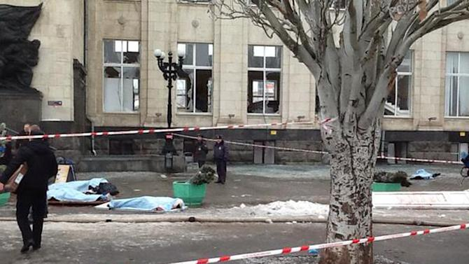 In this photo taken on a cell phone, made available by Volgograd Mayor's Office, bodies lie at an entrance to Volgograd railway station, Sunday, Dec. 29, 2013. More then a dozen people were killed and scores were wounded Sunday by a suicide bomber at a railway station in southern Russia, officials said, heightening concern about terrorism ahead of February's Olympics in the Black Sea resort of Sochi. (AP Photo/Nikita Baryshev,Volgograd Mayor's Office Handout)