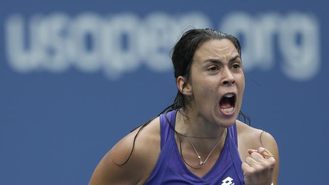 Marion Bartoli of France celebrates during her match with Maria Sharapova, of Russia, in the quarterfinals during the 2012 US Open tennis tournament,  Wednesday, Sept. 5, 2012, in New York. (AP Photo/Darron Cummings)