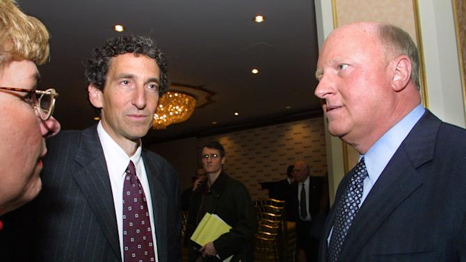 FILE - In this Tuesday, Jan. 22, 2002, file photo, then Tyco International chairman and chief executive Dennis Kozlowski, right, and Tyco chief financial officer Mark Swartz, center, speak to reporters and analysts, in New York. Ex-Tyco executives Dennis Kozlowski and Mark Swartz, who collectively paid $134 million in restitution to Tyco and $105 million in fines to the state after their 2005 convictions, left a minimum-security prison in Harlem for steady clerical jobs and overnights in apartments during September 2013.. The duo will face parole hearing in October 2013. (AP Photo/Shawn Baldwin, File)