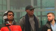 Retired U.S. NBA basketball player Dennis Rodman (C) poses with his team members after arriving in Pyongyang in this still image taken from video, February 26, 2013. REUTERS/KCNA for REUTERS TV