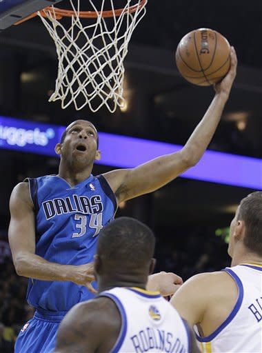Mavericks survive late run, top Warriors 112-103