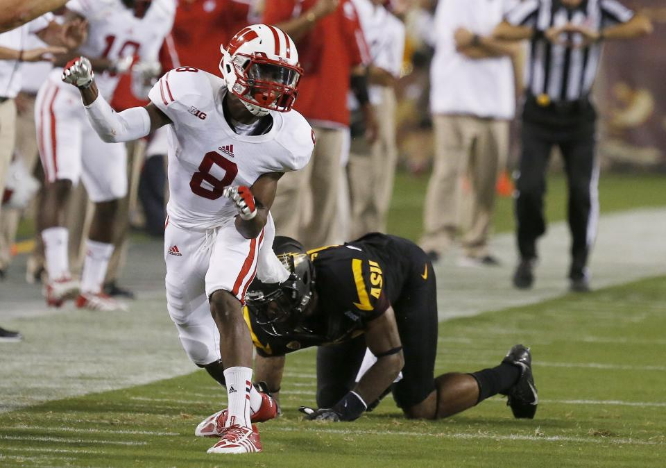 Wisconsin's Sojourn Shelton (8) celebrates as he breaks up a pass intended for Arizona State's Jaelen Strong in the first half of an NCAA college football game on Saturday, Sept. 14, 2013, in Phoenix. (AP Photo/Ross D. Franklin)