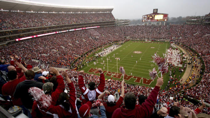 FILE - In this Nov. 28, 2008, file photo, Alabama fans cheer at Bryant-Denny Stadium for the Iron Bowl NCAA college football game between Alabama and Auburn in Tuscaloosa, Ala. (AP Photo/The Tuscaloosa News, Robert Sutton, File)