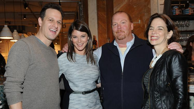Actor Josh Charles, left, FOOD & WINE's Gail Simmons and editor in chief Dana Cowin, right, celebrate Mario Batali, second right, who guest-edited the April issue of FOOD & WINE, during a party at Eataly in New York, Wednesday, March 6, 2013.  (Photo by Diane Bondareff/Invision for FOOD & WINE/AP Images)