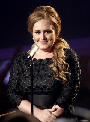 "FILE - In this Sunday Aug. 28, 2011 file photo  Adele performs at the MTV Video Music Awards  in Los Angeles.  British soul singer Adele hopes to cap a spectacular year by winning the Mercury Award for Album of the Year  the U.K. music industry's most prestigious prize for original music. Adele been dominating album and single charts across the globe since the release of ""21"" in January. Her single ""Someone Like You"" has become the summer anthem of 2011. (AP Photo/Matt Sayles)"
