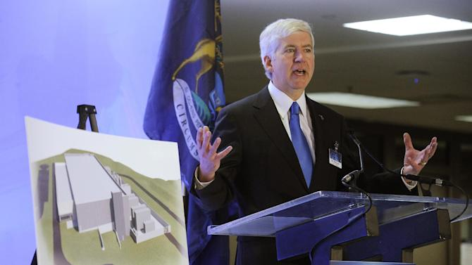 Michigan Governor Rick Snyder speaks at press conference  at the GM Warren Tech Center in Warren,  Mich.,on Monday, May 13, 2013, with illustration of future IT building.   (Daniel Mears / The Detroit News)  (AP Photo/Detroit News, Daniel Mears)  DETROIT FREE PRESS OUT; HUFFINGTON POST OUT