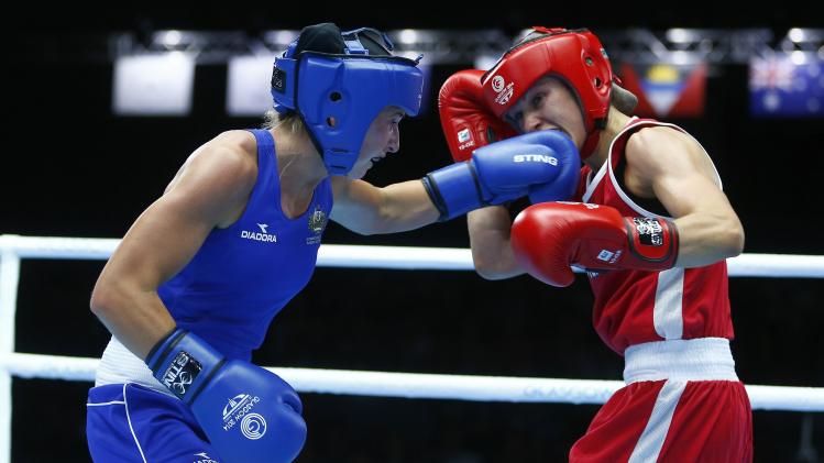 Kristy Harris of Australia and Mandy Bujold of Canada box during their women's flyweight quarter-final bout at the 2014 Commonwealth Games in Glasgow, Scotland