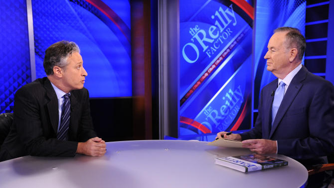 """FILE - This Sept. 22, 2010 file photo shows Comedy Central's Jon Stewart from """"The Daily Show with Jon Stewart,"""" left, and and political pundit Bill O'Reilly during an interview for """"The O'Reilly Factor"""" on FOX News Channel, in New York.  After more than 16 years and nearly 2,600 telecasts, Stewart will end his show on Aug. 6. (AP Photo/Peter Kramer, File)"""