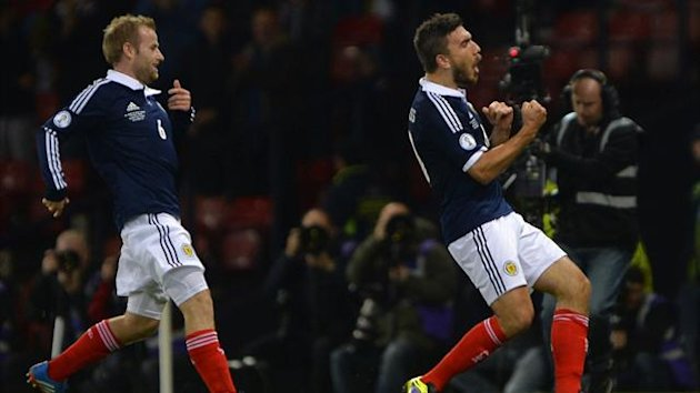 Scotland's Robert Snodgrass (R) celebrates his goal against Croatia during their 2014 World Cup qualifying soccer match at Hampden Park stadium in Glasgow, Scotland, October 15, 2013. REUTERS