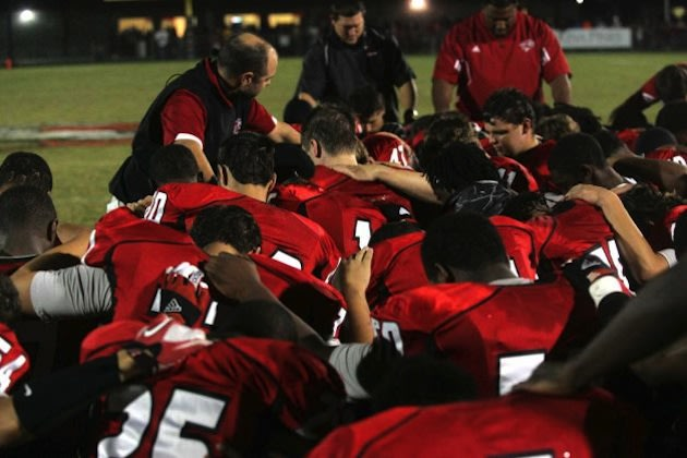 Hartsville players pray for teammate Ronald Rouse — Florence Morning News/AP