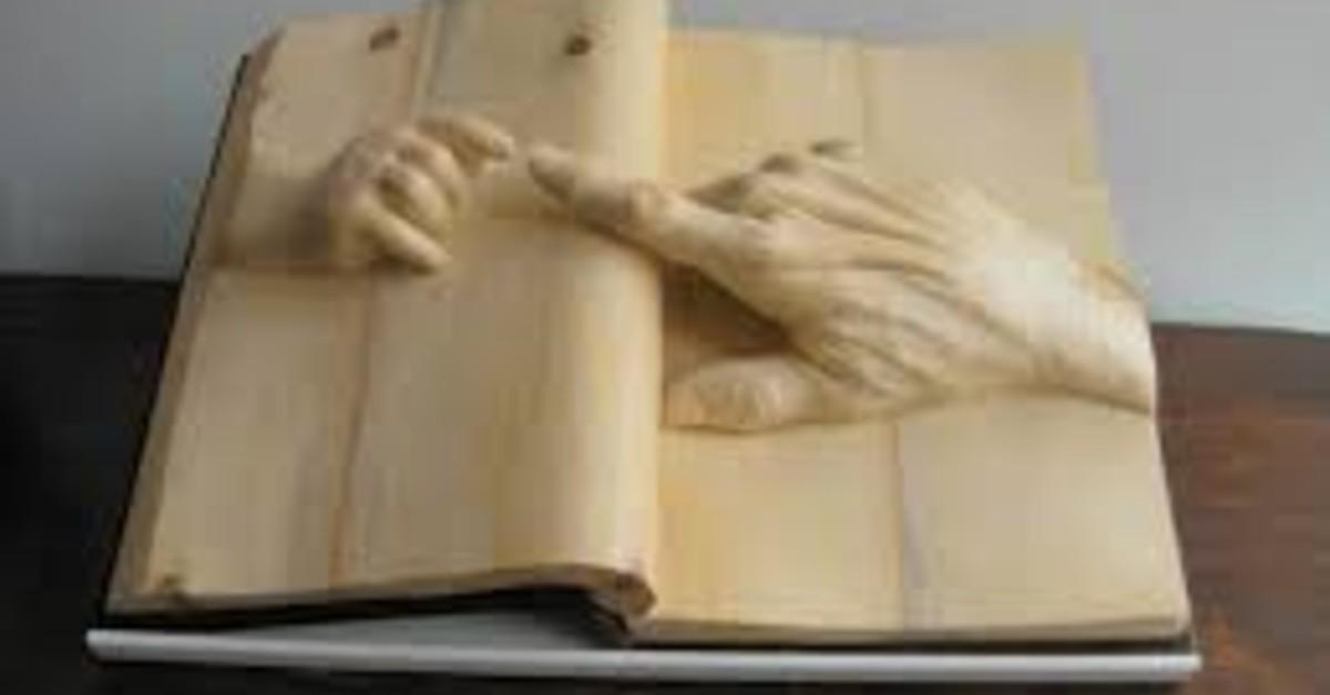 17 Realistic Sculptures Carved Out Of Books