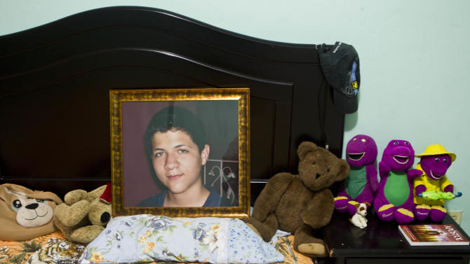 CORRECTS LAST NAME SPELLING AND ADDS FIRST NAME 'EBED' - In this Oct 17, 2012 photo, an image of late Ebed Jaasiel Yanes, 15, sits on his bed at his parent's home in Tegucigalpa, Honduras. According to his relatives, Yanes was killed by soldiers early Sunday, May 27, when he was riding a motorcycle near a military checkpoint.  (AP Photo/Esteban Felix)
