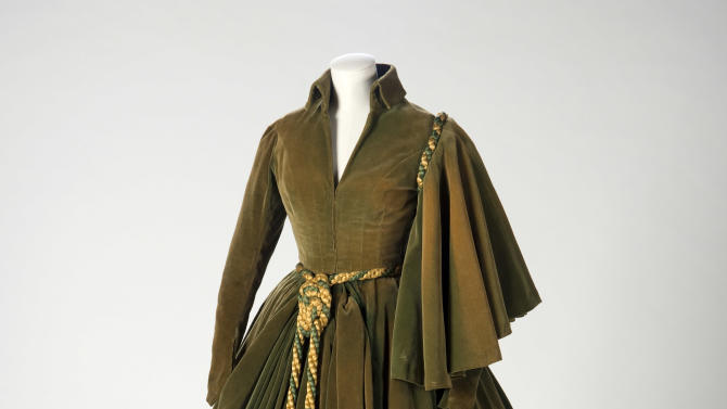 "This undated photo provided by the Harry Ransom Center shows the conserved green curtain dress worn by Vivien Leigh as Scarlett O'Hara in ""Gone With The Wind"". The iconic dress and Scarlett's burgundy ball gown from the 1939 film were saved from deterioration by a $30,000 conservation effort by the Harry Ransom Center at the University of Texas, and are on display for the first time in nearly 30 years at London's Victoria and Albert Museum as part of a Hollywood costume exhibit. (AP Photo/Harry Ransom Center,Pete Smith)"