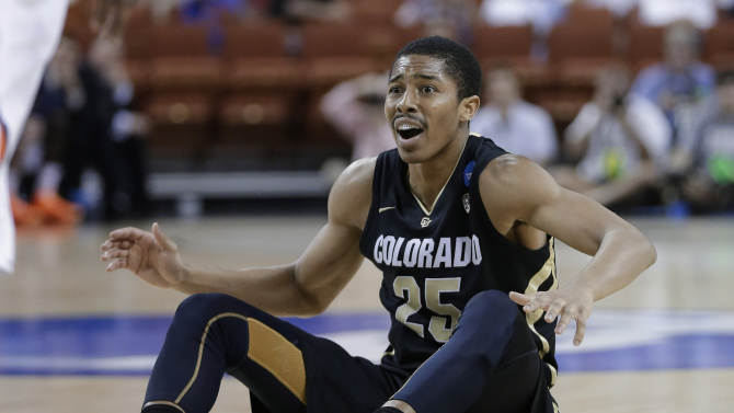 Colorado's Spencer Dinwiddie reacts to what he thought was a foul during the second half of a second-round game of the NCAA men's college basketball tournament Friday, March 22, 2013, in Austin, Texas. Illinois defeated Colorado 57-49. (AP Photo/Eric Gay)