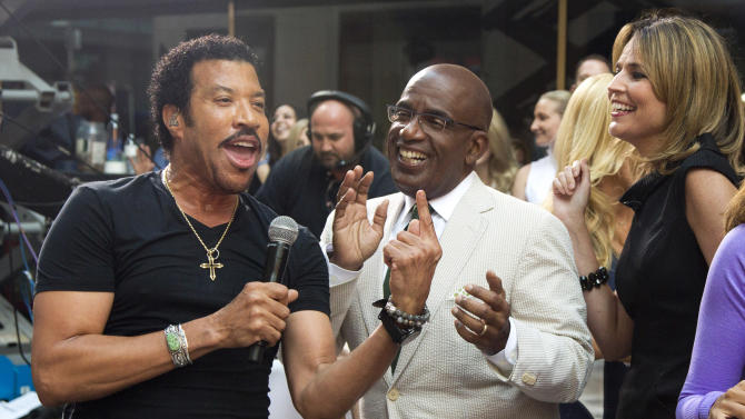 """Lionel Richie, left, sings with Al Roker and Savannah Guthrie while performing on NBC's """"Today"""" show on Thursday, Aug. 16, 2012 in New York. (Photo by Charles Sykes/Invision/AP)"""