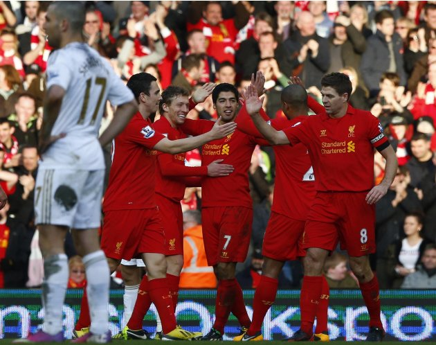 Liverpool's Suarez celebrates his goal against Swansea City during their English Premier League soccer match in Liverpool