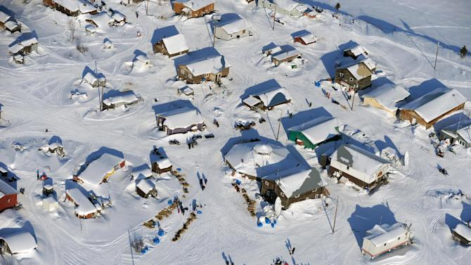 The six front runners of the race all stopped for rest at the Kaltag checkpoint of the Iditarod Trail Sled Dog Race on Saturday, March 10, 2012, in Kaltag, Alaska. (AP Photo/The Anchorage Daily News, Marc Lester)