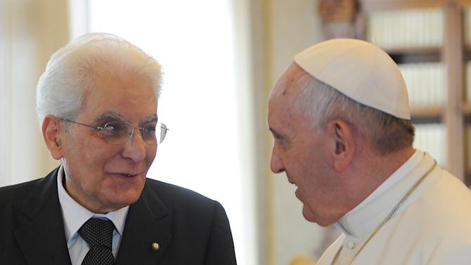 Pope Francis talks with Italian President Sergio Mattarella during a private audience, in the pontiff's studio at the Vatican, Saturday, April 18, 2015. (AP Photo/Maurizio Brambatti, POOL)