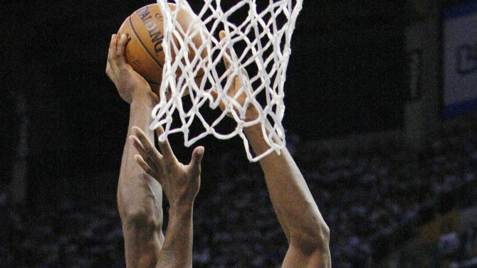Oklahoma City Thunder's Serge Ibaka goes to the basket against Memphis Grizzlies' Zach Randolph, left, during the first half of Game 5 of an NBA basketball playoffs Western Conference semifinal in Oklahoma City, Wednesday, May 15, 2013. (AP Photo/Alonzo Adams)