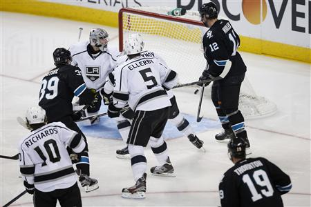 Members of the Los Angeles Kings and San Jose Sharks react to the game-winning shot by Sharks' Couture during Game 3 of their NHL Western Conference semifinal playoff in San Jose