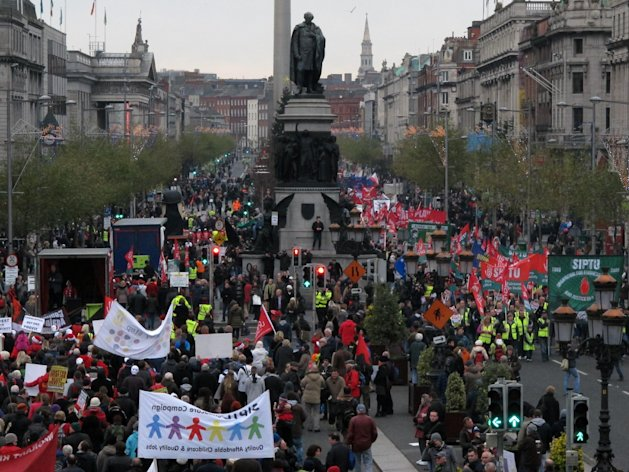 Irish protesters fill Dublin's O'Connell Street in both directions during an anti-austerity march Saturday, Nov. 24, 2012. The government says it will unveil Ireland's sixth straight austerity budget next month in hopes of reducing the country's 2013 deficit to 8.6 percent, still nearly triple the spending limit that eurozone members are supposed to observe. (AP Photo/Shawn Pogatchnik)