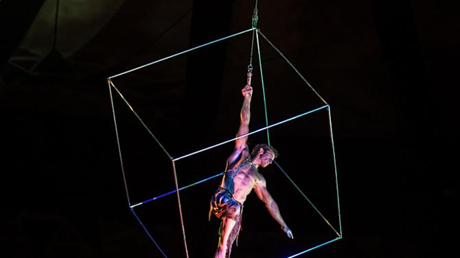 Former British gymnast Paul Bowler performs the aerial cube act in a Cirque du Soleil show