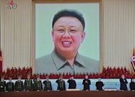 A screen grab from North Korea's state TV shows the picture of late leader Kim Jong-Il at Pyongyang's Kumsusan Memorial Palace during a military parade in February. North Korea held a national memorial service on Sunday to mark the 100th day since Kim's death, hailing the country's nuclear weapons programme as his outstanding feat