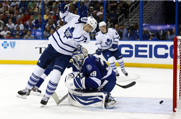 Toronto Maple Leafs' van Riemsdyk screens Tampa Bay Lightning Lindback on a goal during third period NHL game in Tampa, Florida