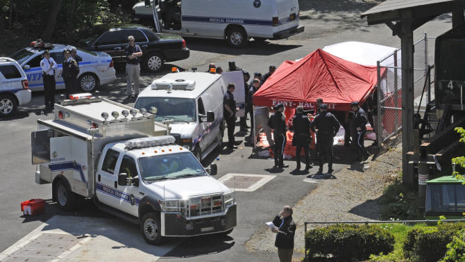 Police surround a temporarily built tent where the victims of the vehicle crash were brought, Sunday April 29, 2012, in New York. Authorities say an out-of-control van plunged off a roadway near the Bronx Zoo, killing seven people, including three children. (AP Photo/ Louis Lanzano)