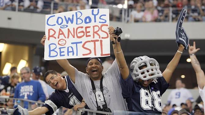 Fans cheer during the NFL football game between the St. Louis Rams and Dallas Cowboys at Cowboys Stadium in Arlington, Texas, Sunday, Oct. 23, 2011. The Cowboys won 34-7. The St. Louis Cardinals and Texas Ranger are playing the World Series in the ballpark across the street. (AP Photo/Sharon Ellman)