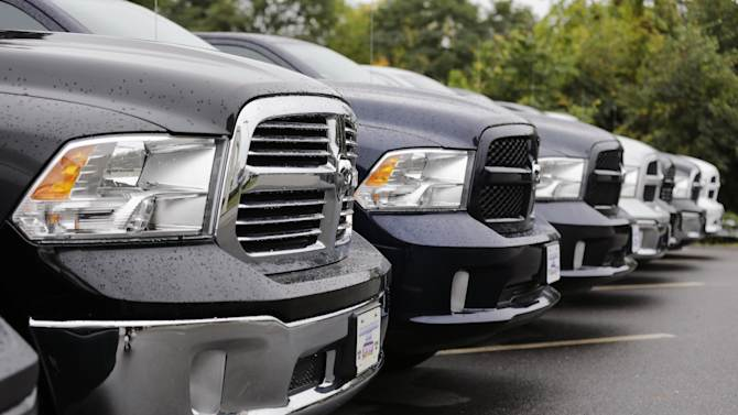 Dodge Ram pickup trucks are lined up for sale at Bill DeLuca's dealerships in Haverhill, Mass., Wednesday, Oct. 1, 2014. Chrysler Group says its U.S. sales rose 19 percent in September thanks to strong demand for the new Jeep Cherokee SUV and the Ram pickup. (AP Photo/Charles Krupa)