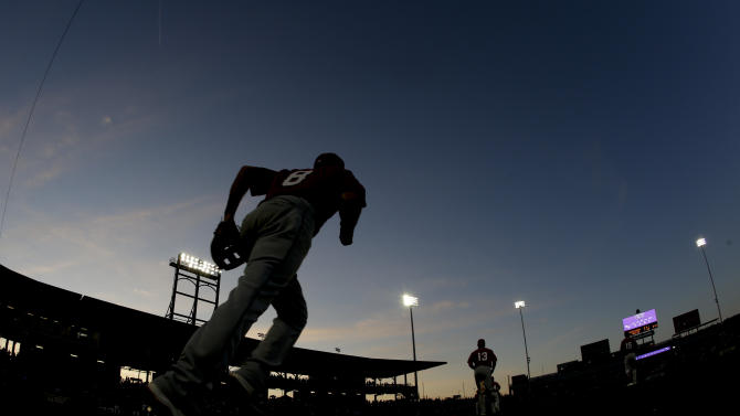 Los Angeles Angels third baseman Taylor Featherston takes the field during the sixth inning of a spring training baseball exhibition game against the Chicago Cubs in Mesa, Ariz., on Thursday, March 26, 2015. (AP Photo/Chris Carlson)