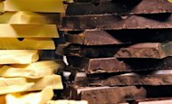 This file illustration photo shows white and black chocolate bars on display at a chocolate fair. Australian chocolate retailer Darrell Lea, which has stores across Australia, New Zealand and the United States, was placed into voluntary administration on Tuesday with 700 jobs at risk