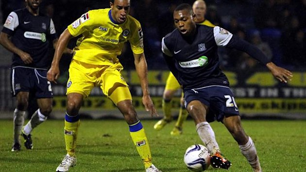Britt Assombalonga, right, will stay at Southend all season