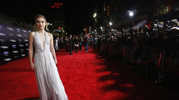 "Cast member Poots poses at the premiere of the film ""Need for Speed"" at the TCL Chinese theatre in Hollywood"