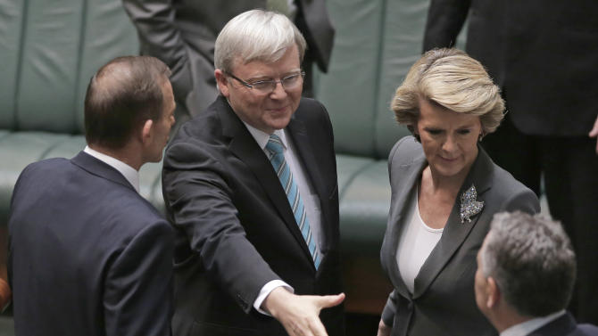 Australian Prime Minister Kevin Rudd, second from left, is congratulated by opposition leader Tony Abbott, left, deputy opposition leader Julie Bishop, right, and shadow treasurer Joe Hockey just before Rudd addresses Parliament for what is likely to be its last day before elections, in Canberra, Australia, Thursday, June 27, 2013. Rudd was sworn in as Australian prime minister three years and three days after he was ousted from the same job in an internal government showdown. (AP Photo/Rick Rycroft)