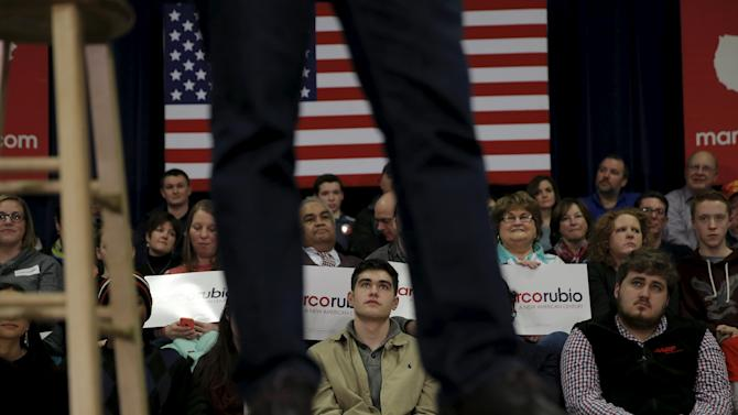 Voters look on as U.S. Republican presidential candidate Marco Rubio speaks at a town hall campaign rally in Derry