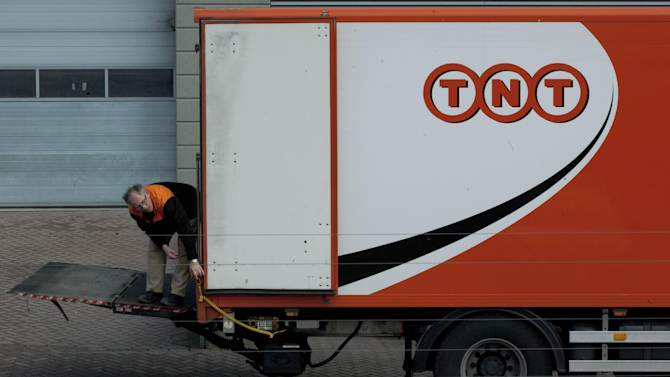 FILE - In this Feb. 21, 2012 file photo a TNT employee operates a delivery truck in Hoofddorp, near Amsterdam, Netherlands. United Parcel Service Inc. has ditched its euro5.2 billion (US$6.9 billion) takeover of TNT Express NV after learning that European regulators would reject the deal in its current form. (AP Photo/Peter Dejong, File)