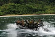 Philippine and US marines speed towards the shore of Tagcauayan beach during a beach raid simulation as part of their joint military exercise in Puerto Princesa, Palawan island, on April 23. The Philippines, lamenting the poor state of its armed forces, appealed Monday for US and international help in building a &quot;minimum credible defense&quot; amid an escalating territorial dispute with China