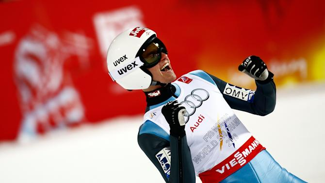 Poppinger of Austria reacts after his jump in the men's large hill team ski jumping final at the Nordic World Ski Championships in Falun