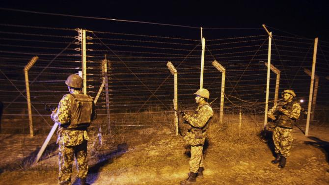 Indian Border Security Force (BSF) soldiers stand guard during a night patrol near international border fencing at Suchet Garh in Ranbir Singh Pura, about 27 kilometers (17 miles) south of Jammu, India, Thursday, Jan. 10, 2013. The Pakistani army accused Indian troops of firing across the disputed Kashmir border and killing a soldier Thursday, the third deadly incident in the disputed Himalayan region in recent days. (AP Photo/Channi Anand)