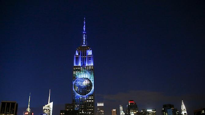 An image of the earth is projected onto the Empire State Building as part of an endangered species projection to raise awareness, in New York