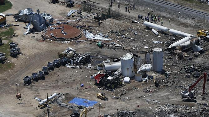 """FILE - The damage from the fertilizer plant explosion is seen from helicopters in accompanying President Barack Obama in West, Texas, in this April 25, 2013 file photo. The U.S Chemical Safety Board will tell a Senate committee Thursday June 27, 2013 that regulation of the dangerous chemicals used in the industry fall under a """"patchwork"""" of standards that are decades old and are far weaker than rules used by other countries. The findings will be presented to the U.S. Senate Committee on Environment and Public Works. (AP Photo/Charles Dharapak, File)"""