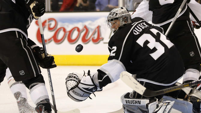 Los Angeles Kings goalie Jonathan Quick looks at the puck during the first period of an NHL hockey game against the Chicago Blackhawks in Los Angeles, Saturday, Jan. 19, 2013. (AP Photo/Jae C. Hong)