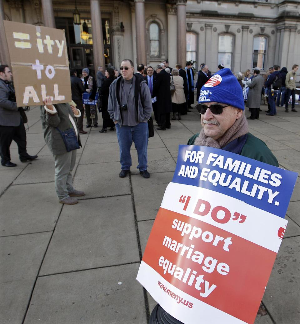 Mel LeCompte, of Clementon, N.J., holds a sign supporting a bill to legalize gay marriage, as he joins others outside the Statehouse in Trenton, N.J., waiting to attend a Senate Judiciary Committee hearing on the measure Tuesday, Jan. 24, 2012. (AP Photo/Mel Evans)