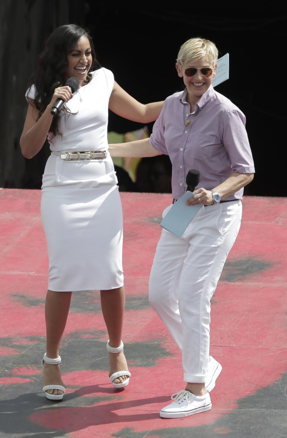 U.S. talk show host Ellen DeGeneres greets Australian singer and actor Jessica Mauboy during a recording session of DeGeneres' show in Sydney, Australia, Saturday, March 23, 2013. (AP Photo/Rick Rycroft)