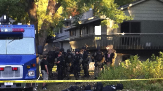 Police investigate a shooting at Accent Signage Systems on the north side of Minneapolis Thursday, Sept. 27, 2012, that left at least two people dead and four others wounded. (AP Photo/Amy Forliti)
